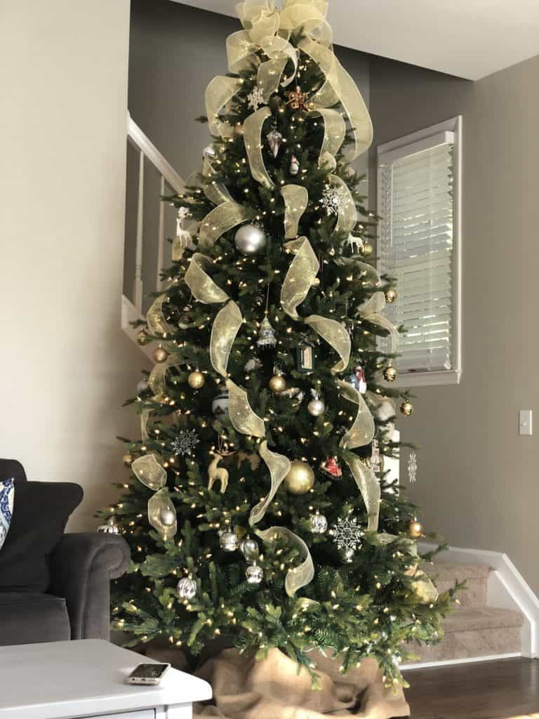Christmas tree decorated with gold ribbons and ornaments