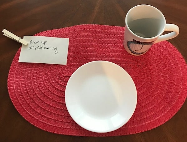 Another clothespin hack is to clip a note to your placemat as a reminder.