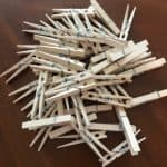Package of clothespins scattered across a table