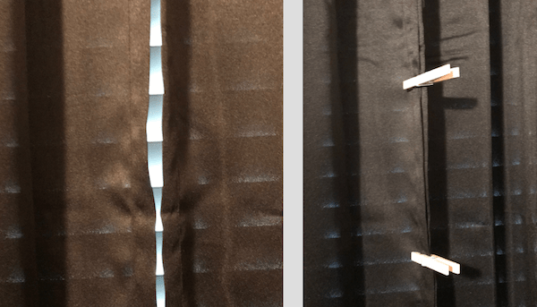 Keep hotel curtains closed by using a couple of clothespins.