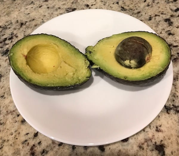 Cut avocado before stuffing it with tuna