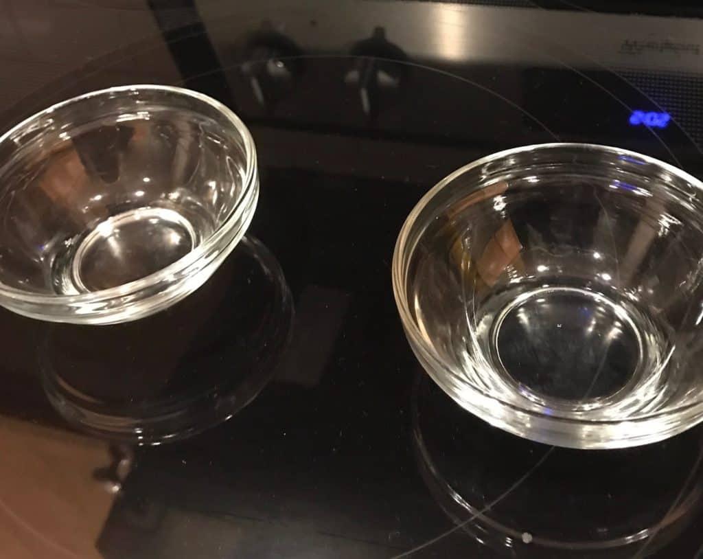 Two clear glass custard cups.