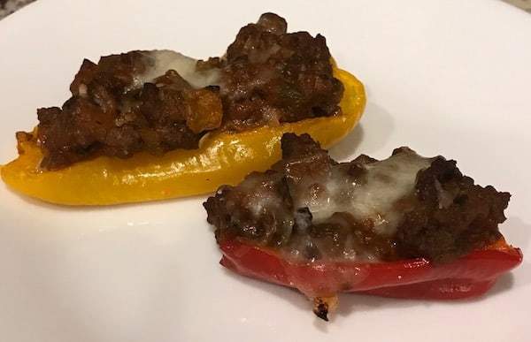 2 mini sweet peppers stuffed with Italian sauce and topped with melted cheese