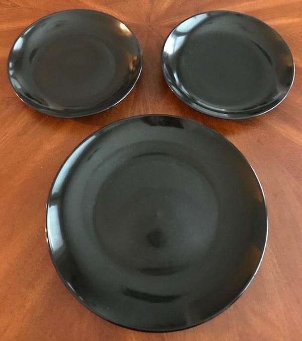 1 black dinner plate and 2 black salad plates