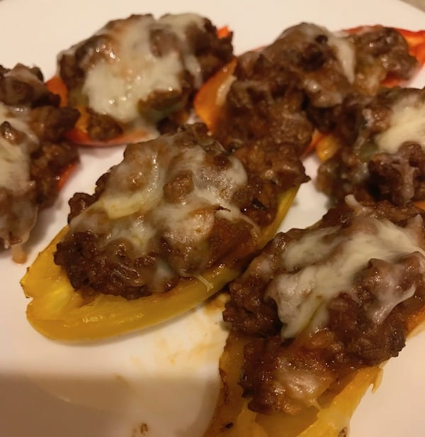 6 mini stuffed peppers with melted cheese