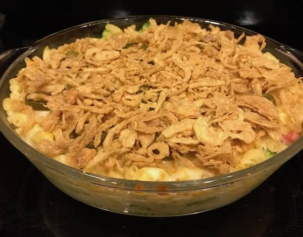 Add ham to the mac and cheese casserole and top with fried onions.
