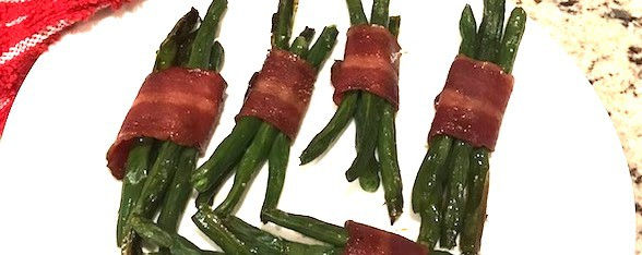 Plate with green bean bundled with bacon