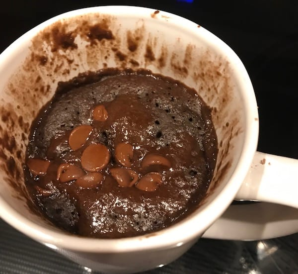 Melted chocolate chips added to the top of a chocolate mug cake