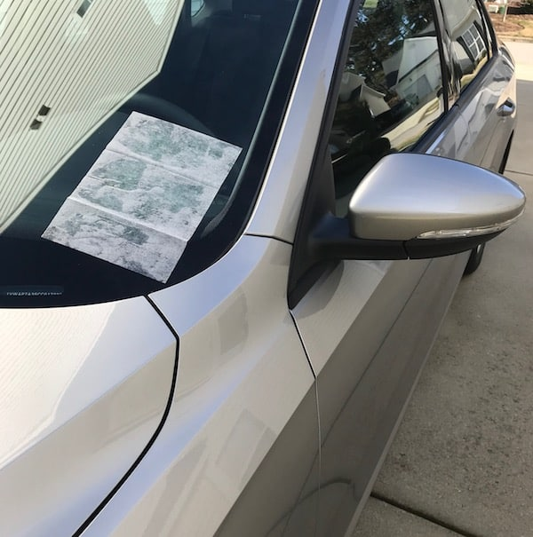 Damp dryer sheet on the car window
