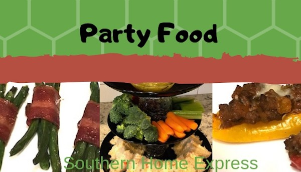 Party snacks, sandwiches, vegetables, dip, and other finger foods