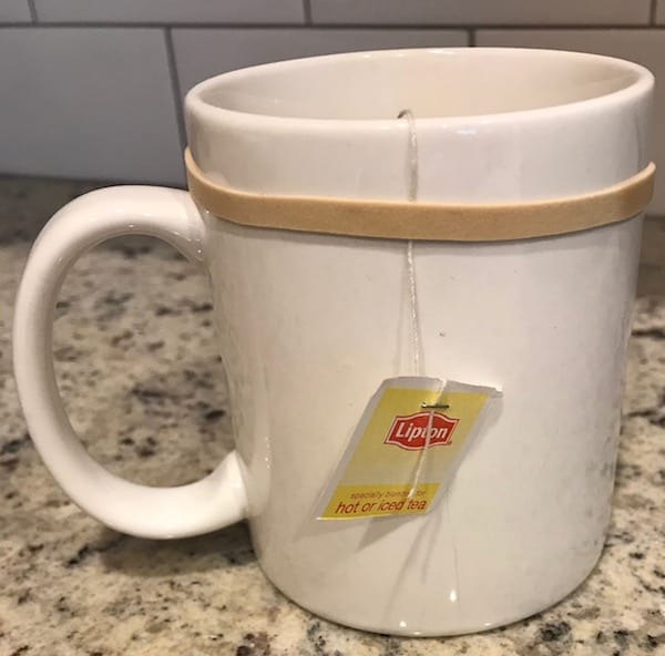 Rubber band holding the tea bag to keep it from slipping into the mug