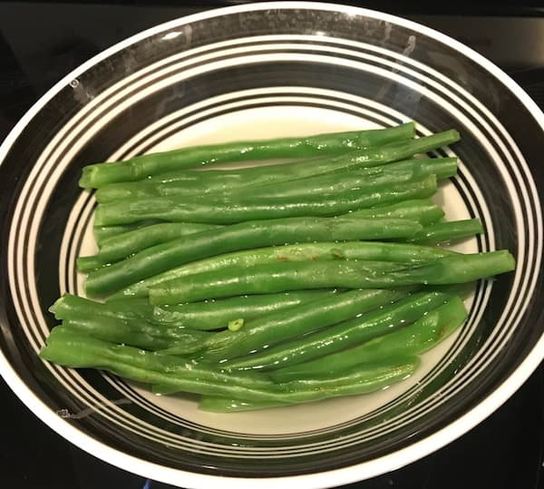 Fresh steamed green beans in a bowl