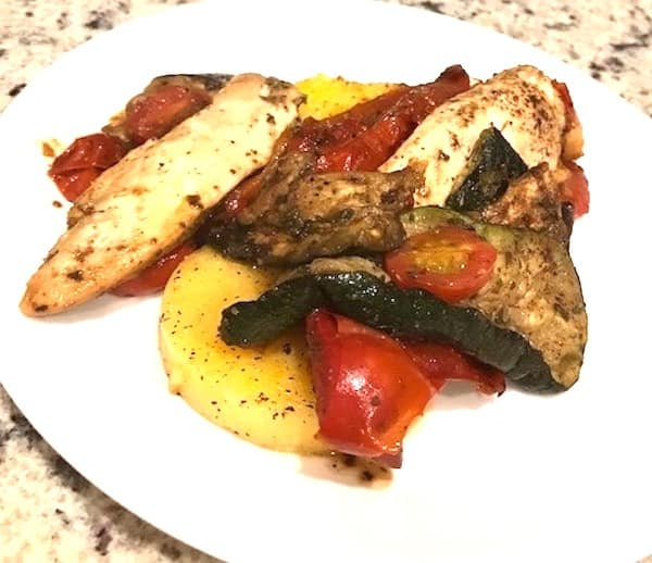 Chicken, eggplant, and tomatoes served over polenta