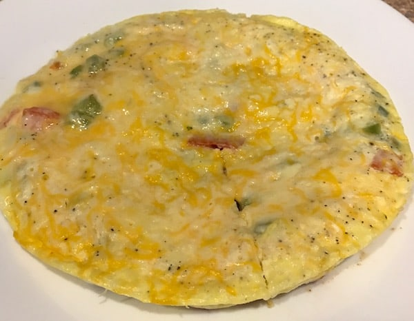 Whole cooked rice cooker frittata on a plate