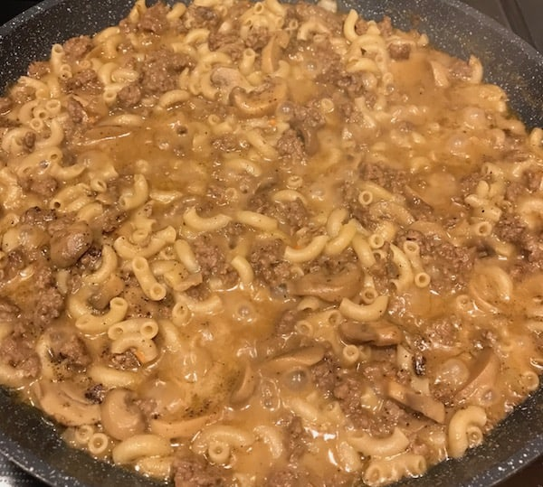 Ground beef with noodles and gravy in a skillet