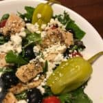 Greek salad with chicken, vegetables, and feta cheese