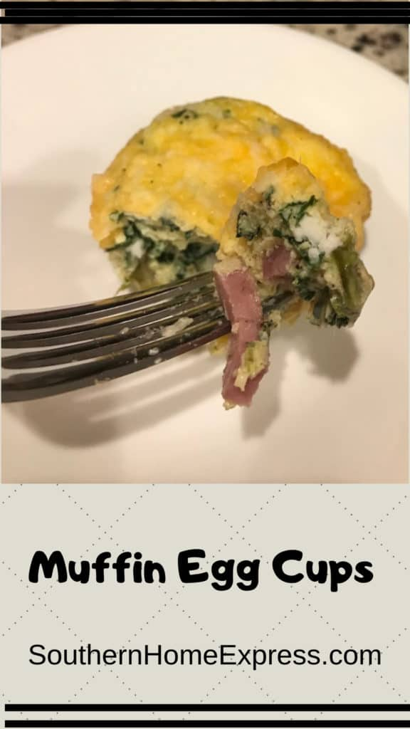 Fork cutting into a vegetable and ham egg muffin cup