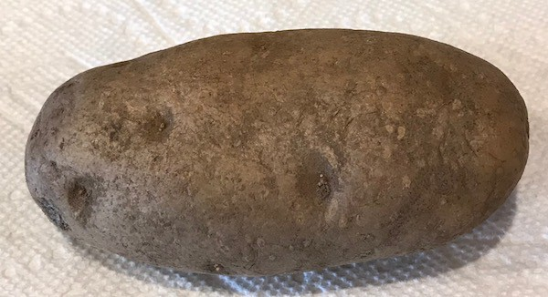 Uncooked spud on a paper towel