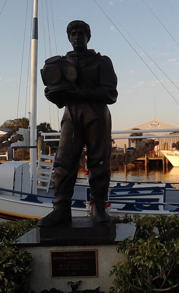 Statue of a sponge diver on the Sponge Docks in Tarpon Springs, FL