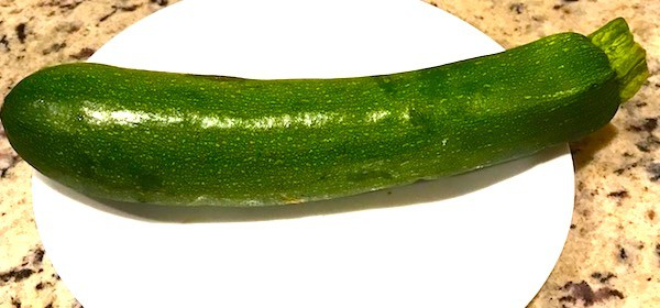 Whole fresh zucchini on a plate