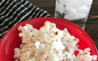 Bowl of popcorn and glass of ice water