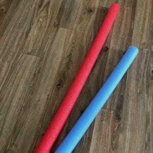 2 pool noodles in different colors