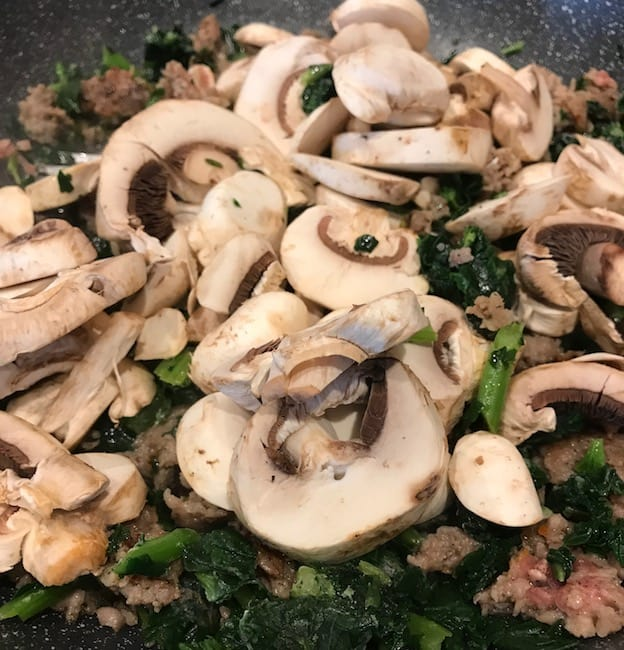Add the sliced mushrooms.