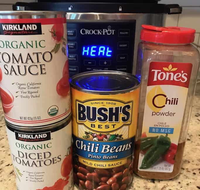 Containers of diced tomatoes, tomato sauce, chili beans, and chili powder