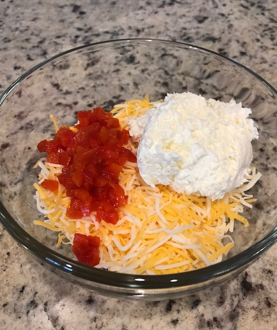 Bowl of shredded cheese, chopped pimentos, and cream cheese