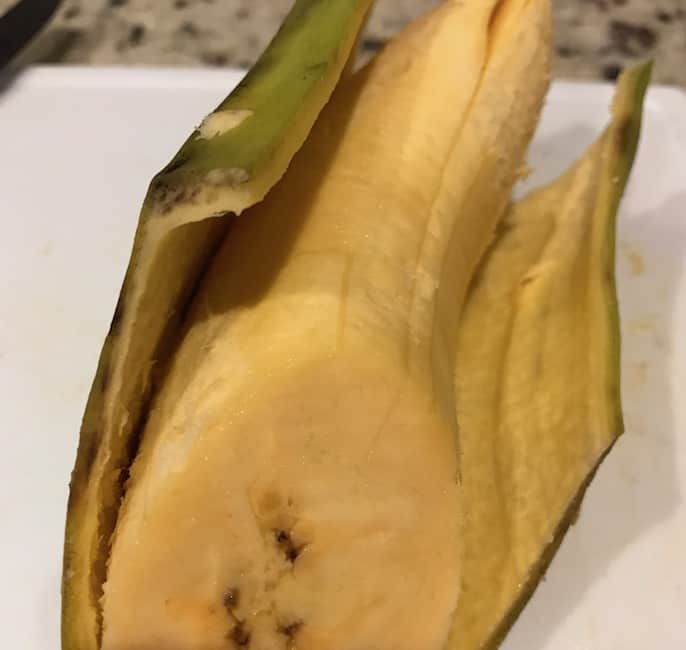 Peel back the plantain skin before you oven fry it.