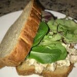Chicken salad sandwich with lettuce served on gluten-free bread