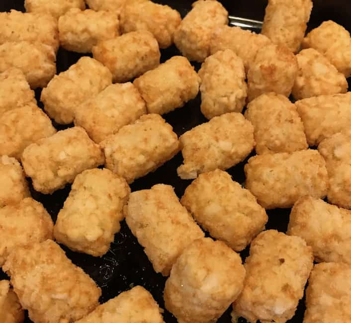 Start out with a layer of tater tots in the casserole dish.