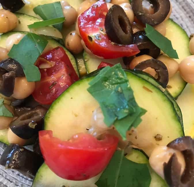 This zucchini and squash salad is also loaded with tomatoes, olives, and other delicious ingredients.
