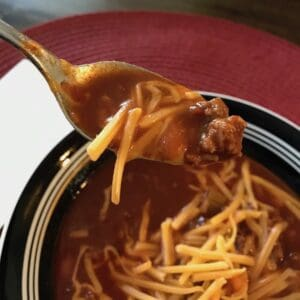 Spoon of Instant Pot chili with cheese