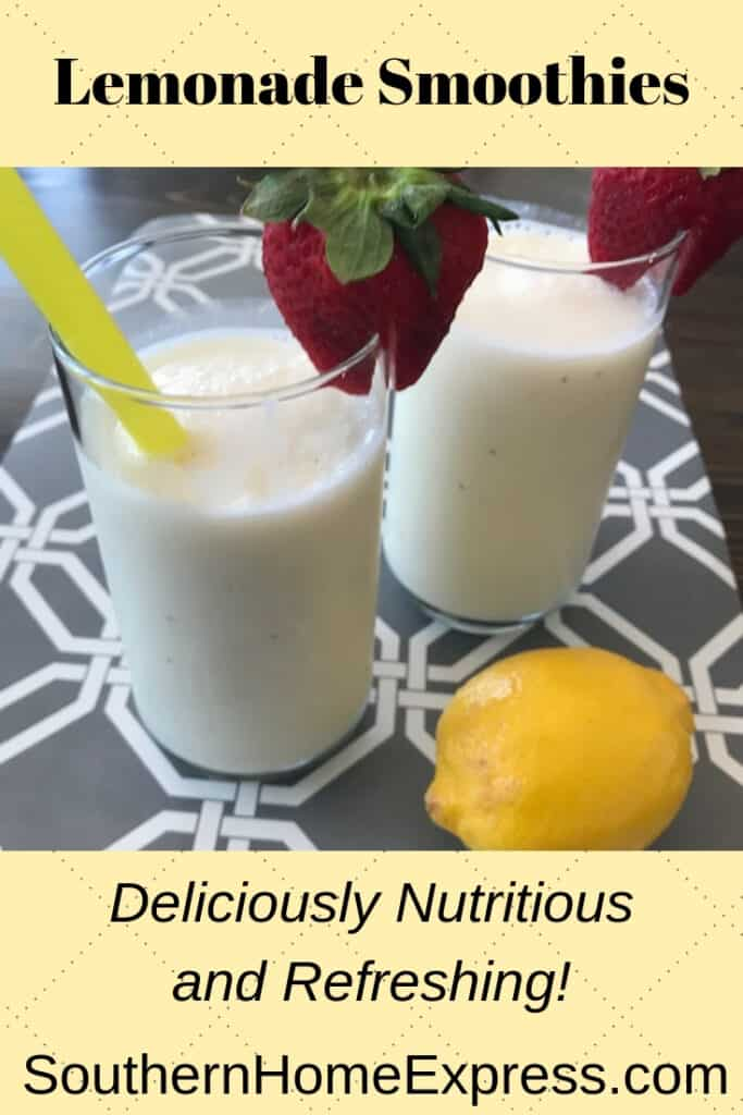 A couple of lemonade smoothies garnished with strawberries