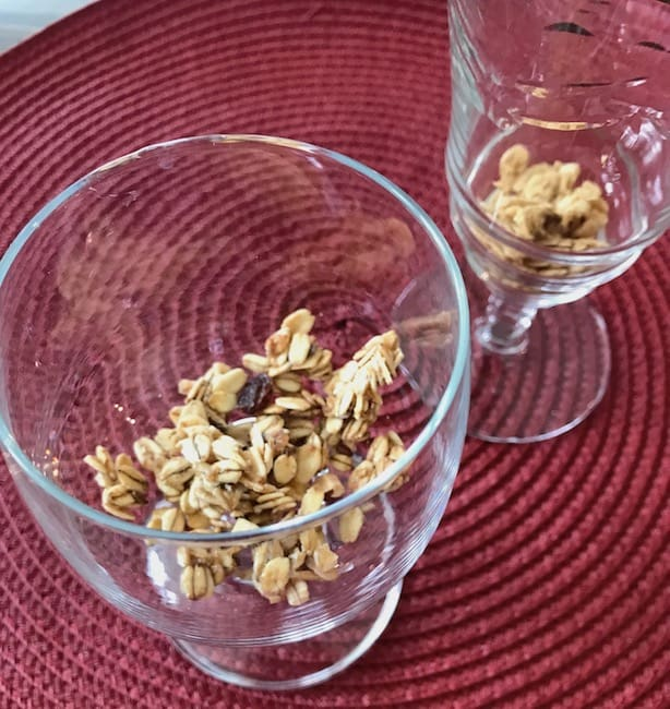 Start with a layer of granola in your parfait dishes.