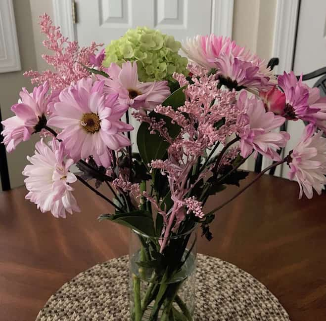 A beautiful cut flower centerpiece adds to the ambiance and charm of a southern home.