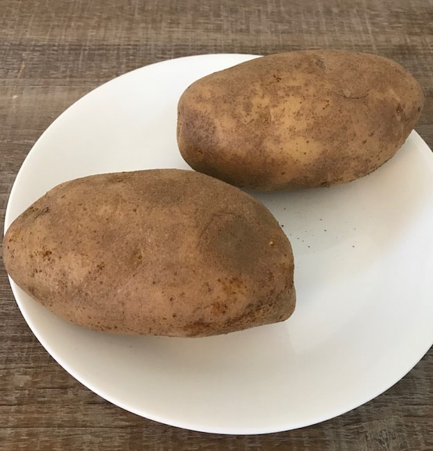 2 potatoes on a plate
