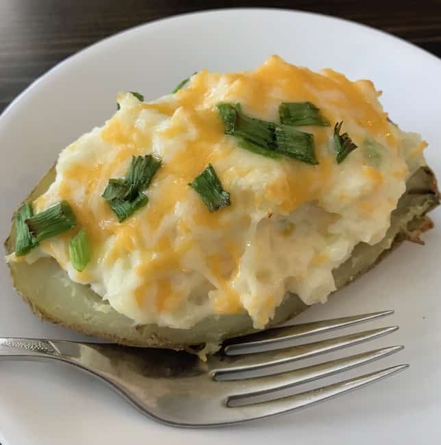 Twice stuffed potato with melted cheese and green onions.
