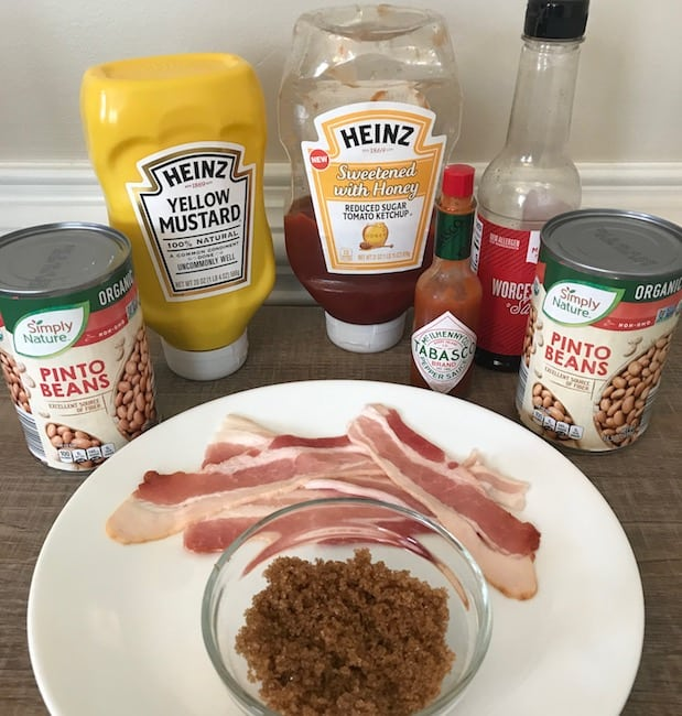Pinto beans, mustard, ketchup, Worcestershire sauce, Tabasco, bacon strips, and brown sugar.