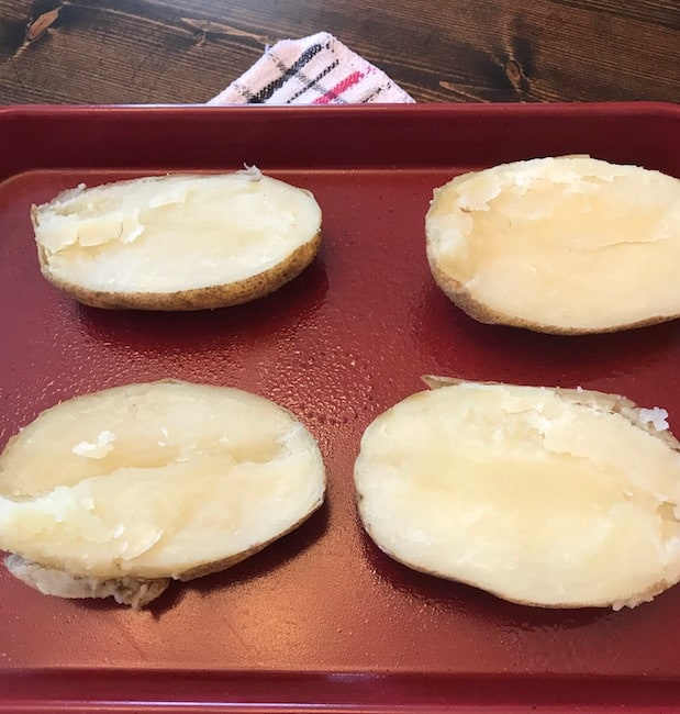 Halved potatoes before they're stuffed and baked the second time.