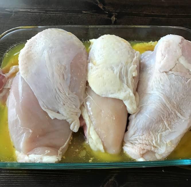 Chicken in a casserole dish.