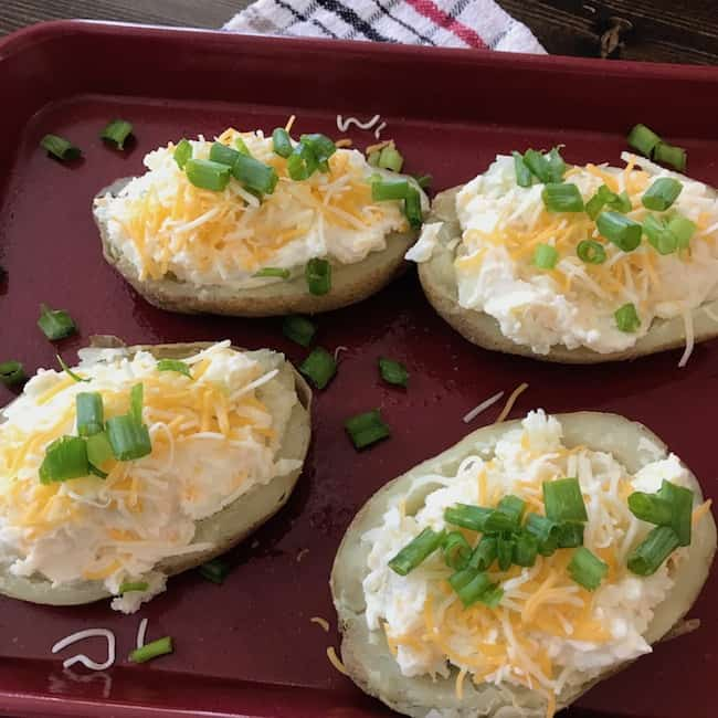 Twice baked potatoes before they are baked the second time.