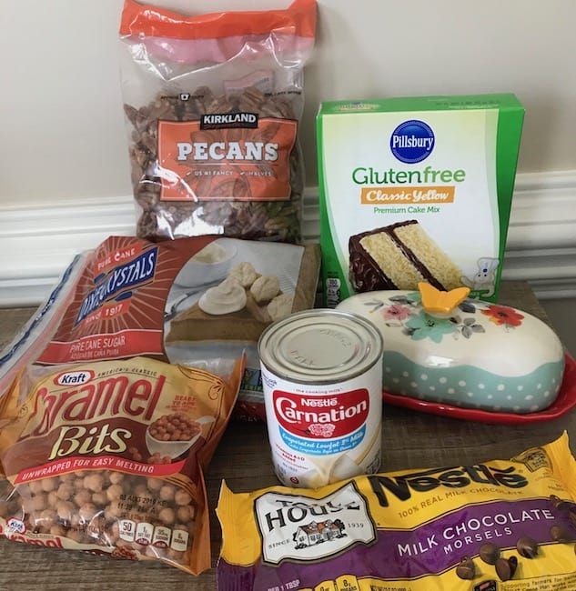 Cake mix, pecans, brown sugar, caramel bits, chocolate chips, evaporated milk, and butter