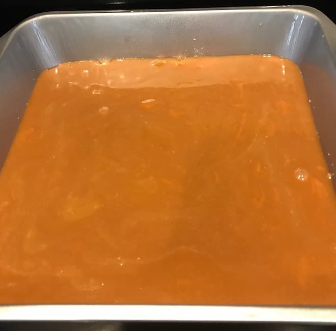 Caramel poured over bottom crust